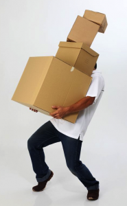 man carrying many boxes